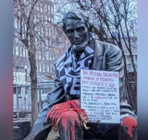 Boise Lincoln statue defaced with Black Lives Matter flag, paint, and feces - Screenshot courtesy of KTVB