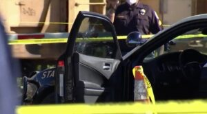 Four bullet holes can be seen in the trooper's patrol car - Screenshot courtesy of NBC News