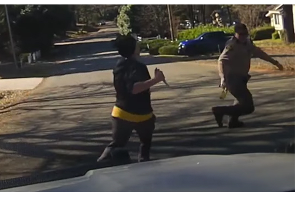 """""""Innocent victim""""? Police release footage of woman with knife charging at deputy before being shot"""