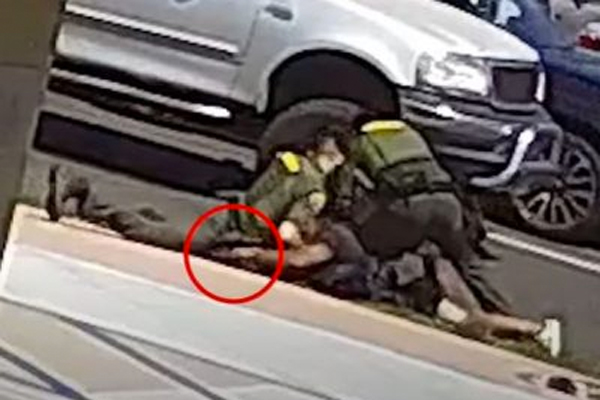 After 'activists' say cops 'murdered' homeless man, police release footage showing 'victim' grab cop's gun