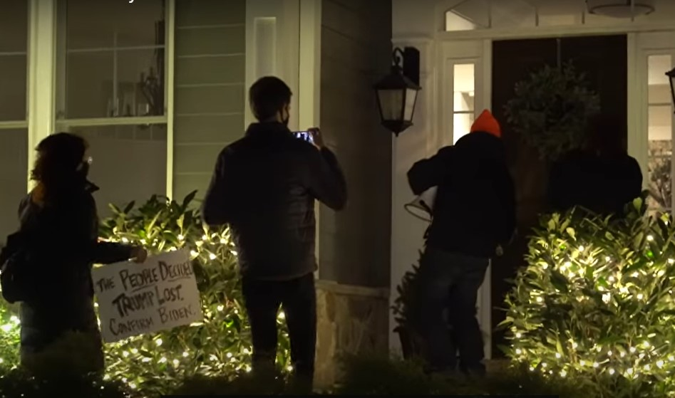 ShutdownDC protesters at front door of Hawley home - Screenshot courtesy of Alchymedia TV on YouTube