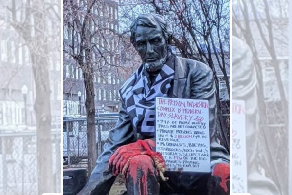 Statue of Abraham Lincoln defaced with feces, red paint, 'defund the police' signs, and Black Lives Matter flag