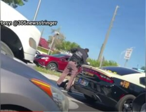 Trooper stands over wounded gunman - Screenshot courtesy of WPLG on YouTube