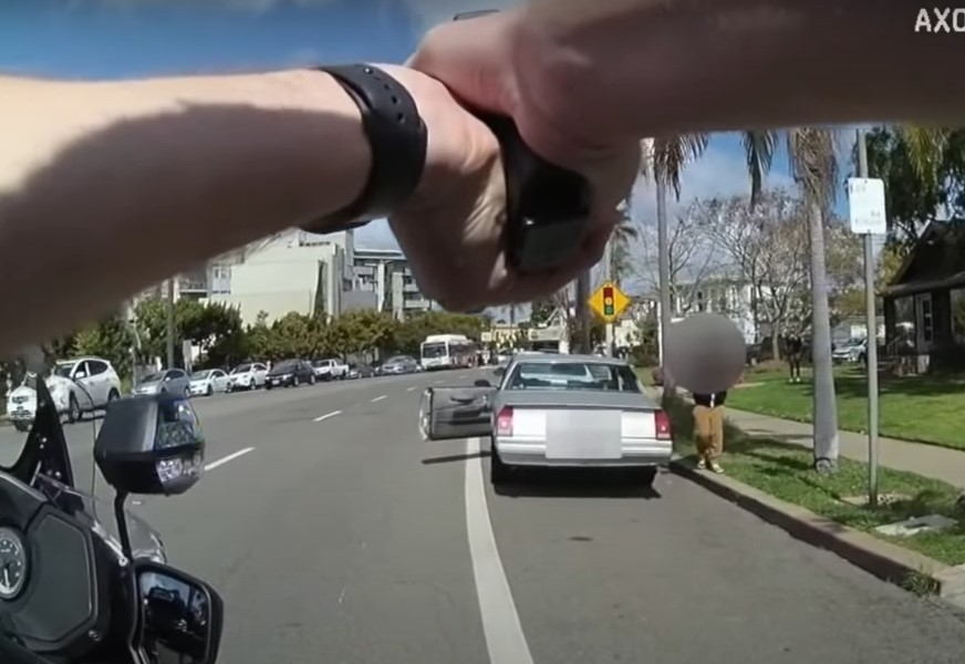 Body camera video shows officer pointing away from child during San Diego Stop - Screenshot courtesy of SDPD on YouTube