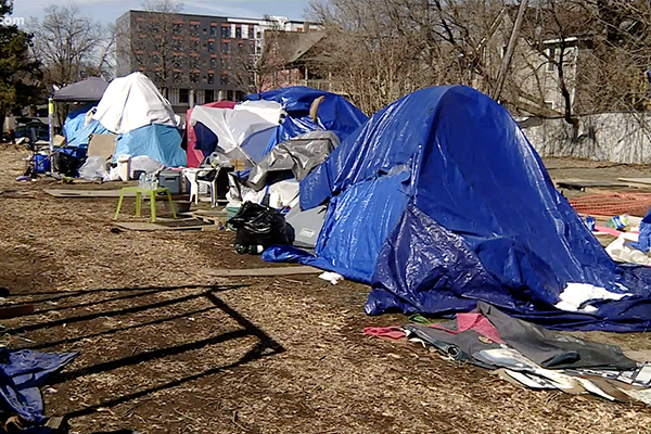 Activists attack officers trying to clear homeless encampment in Minneapolis, punching and choking cops