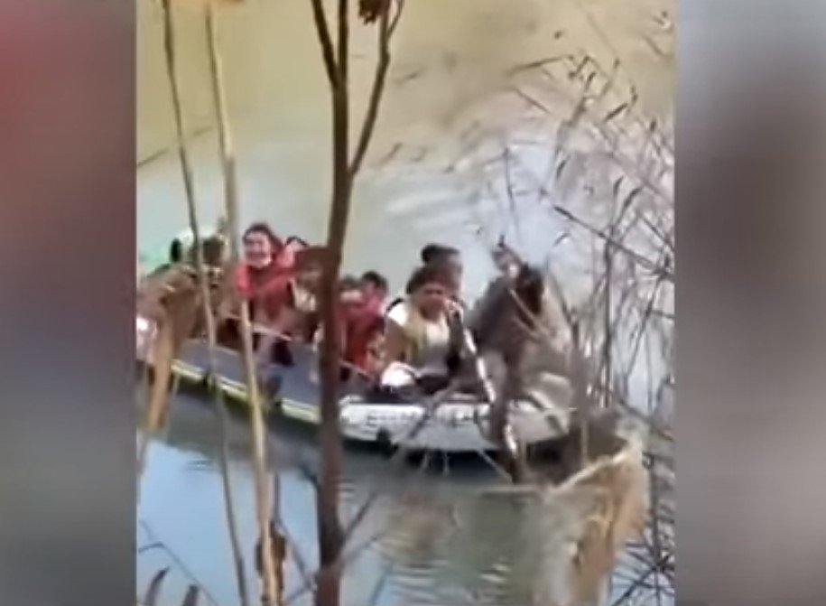 Illegal aliens crossing th Rio Grande with help from a trafficker - Screenshot courtesy of Fox News on YouTube