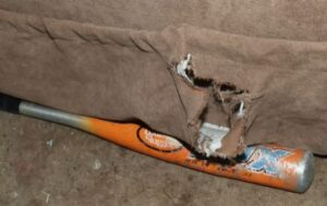 Portion of recliner where shotgun was recovered, showcasing area where blast came from - Wichita Police Department