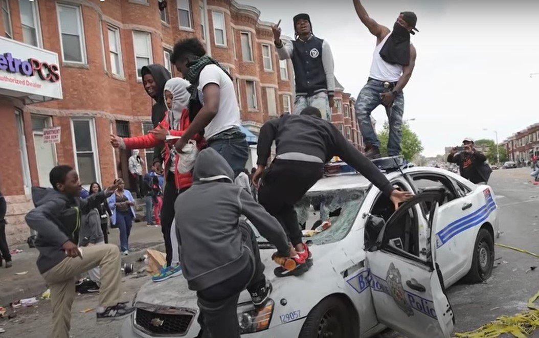Rioters attack Baltimore police vehicle during 2015 riots - Screenshot courtesy of Wall Street Journal on YouTube