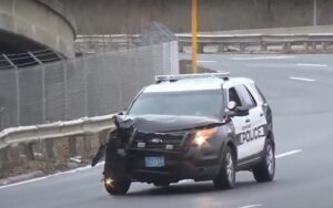 Police SUV damaged during pursuit - Screenshot courtesy of WCVB on YouTube
