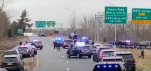 Suspect flees in police vehicle from on ramp - Screenshot courtesy of WCBV on YouTube