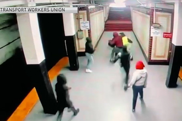 Caught on camera: Group of ten teens violently attack worker in train station - 'It was like a game to them'