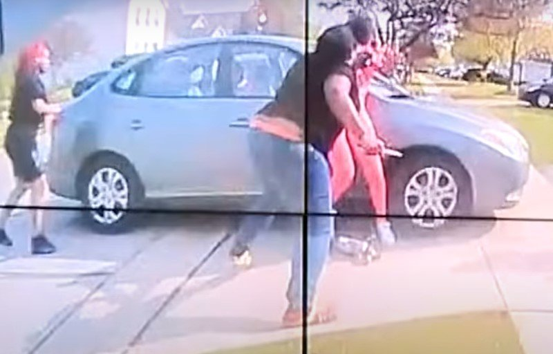 A knife can clearly be seen in the teen's right hand as she attacks another girl - Screenshot courtesy of Breaking News Now on YouTube