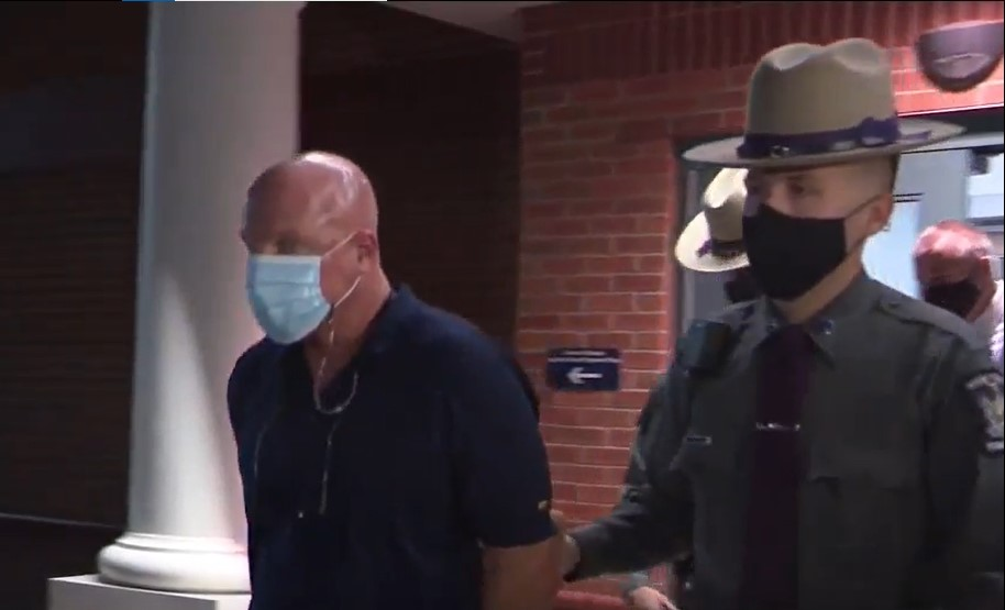 Elementary School Principal Kirk Ashton is led from arraignment on charges of sexually assaulting students - Screenshot courtesy of WLOS