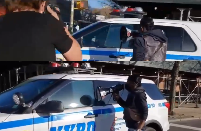 Video: Group unduly harasses NYPD officers in squad car