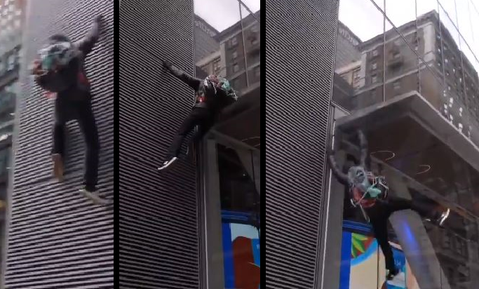 Video: Man falls trying to climb building in effort to vandalize it