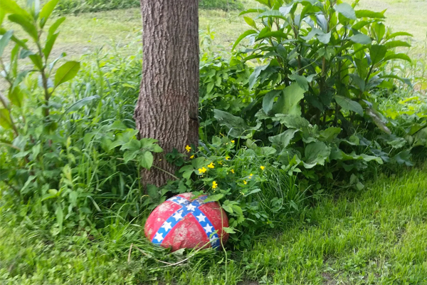 Rock painted with Confederate flag in woman's driveway could cost her the custody of her multiracial child