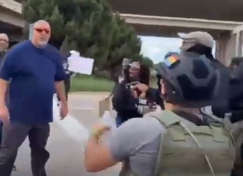 BLM protester points what appears to be a gun at motorist - Screenshot courtesy of TWT on YouTube
