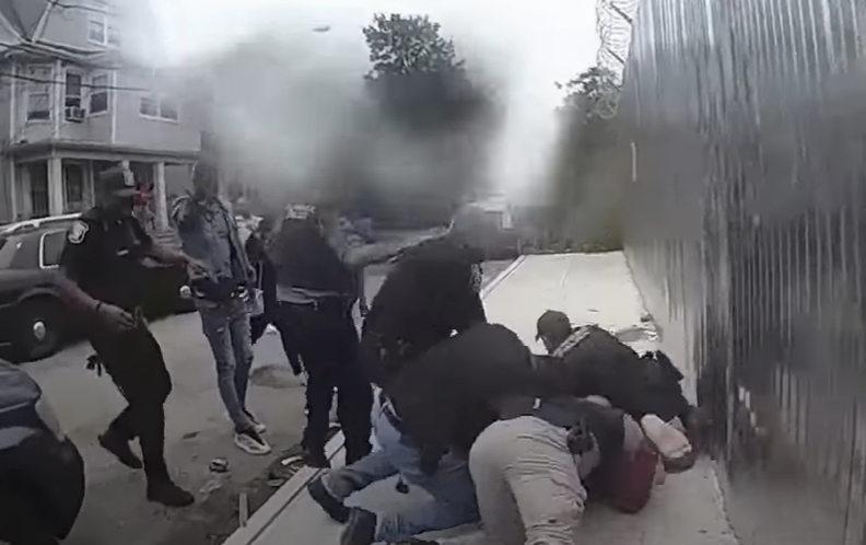 After mayor claims cops lied, PD release footage showing officers attacked by group while trying to make an arrest