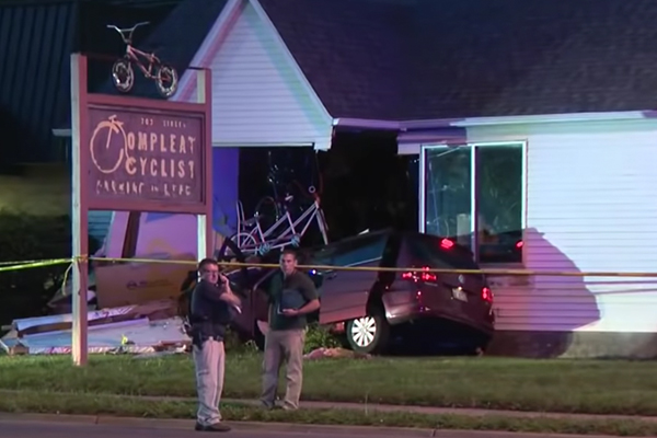 Woman drags officer with car, runs over another cop, crashes into store