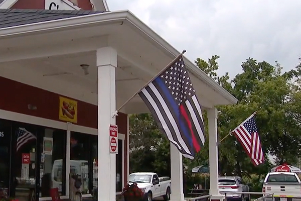Hot dog restaurant owner ticketed for flying Thin Blue Line flag, American flag in front of his business: 'Not backing down'