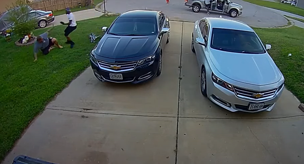 VIDEO: Man sitting in driveway is suddenly attacked by two gunmen