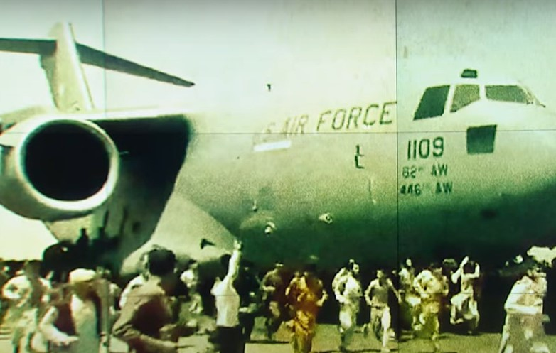 Afghans crowd U.S. Air Force aircraft as they try to flee Taliban - Screenshot courtesy of Al Jazeera English on YouTube