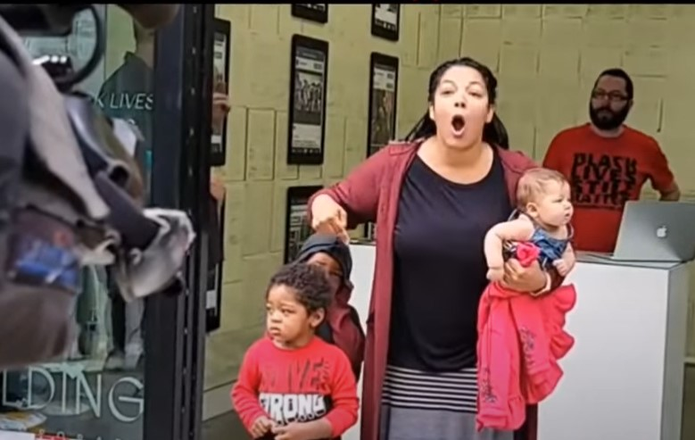 Angry mother crashes press conference to scolb news media - Screenshot courtesy of The Black Conservative Preacher on YouTube