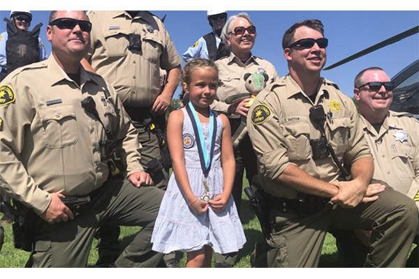 Little hero: Sheriff's department honors little girl, 7, who saved a lost 71-year-old man suffering from Alzheimer's