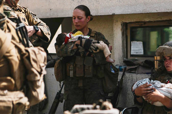 Say her name: U.S. Marine Nicole Gee, who just posted picture of her with Afghan baby, murdered by terrorists. She was 23.