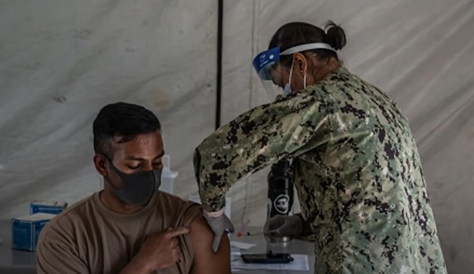 U.S. serviceman received COVID-19 vaccination - Screenshot courtesy of NBC News on YouTube