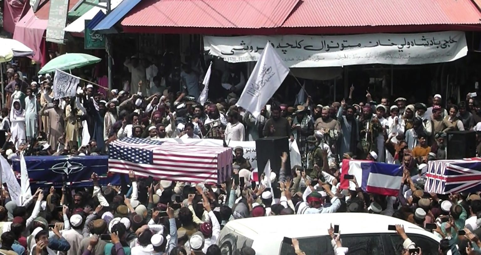 Taliban celebrates the end of 'occupying forces' with mock funeral, flag draped caskets of U.S. and allies
