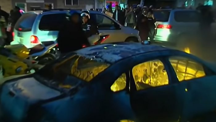A vehicle burns during the 2015 Freddie Gray riot - Screenshot courtesy of ABC News on YouTube