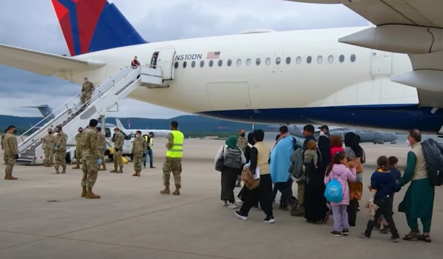 Afghan refugees board a flight from Ramstein Air Base - Screenshot courtesy of Armed Forces Zone on YouTube