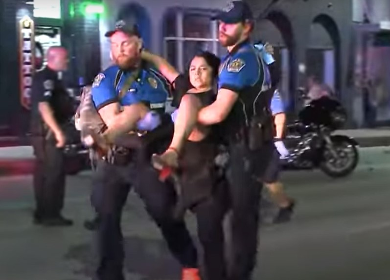 Austin police carrying victim during mass shooting incident in the city in June - Screenshot courtesy of KVUE on YouTube