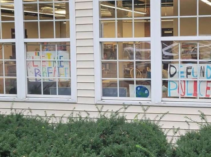"""Spokesman: """"Defund police"""" poster in elementary school window is """"children's sign for student protest"""""""