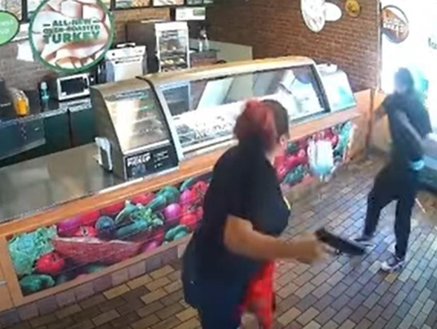 Subway employee suspended for defending herself against robber