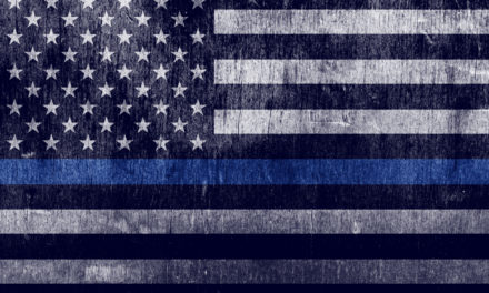 Veteran hangs his own tribute to officers in place of removed thin blue line flag