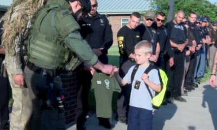 Son of fallen Indiana police officer greeted by 70 cops upon return to school