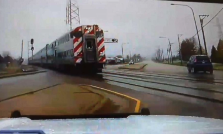 Heart-stopping video shows officer swerve off road to narrowly miss speeding commuter train