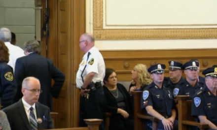 Officer's widow lashes out at accused killer in court