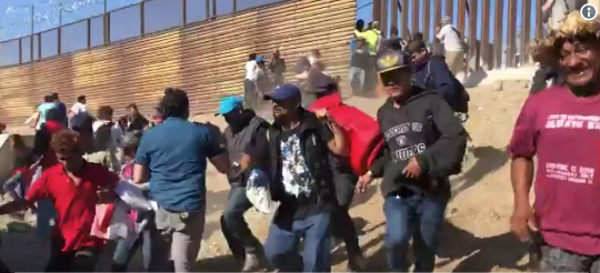 50 migrants in custody after chaotic rush at the border